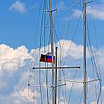 Two masts and a flag